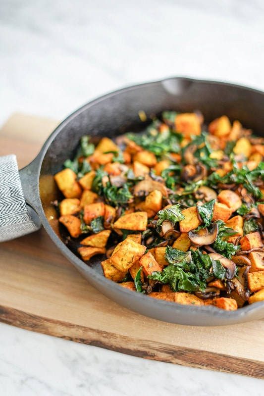 front view Potato, Mushroom and Kale Hash in a cast-iron skillet