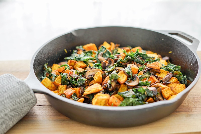 Potato, Mushroom and Kale Hash in a cast-iron skillet