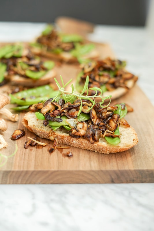 Close-up view of Roasted Mushroom, Onion and Snow Pea Crostini