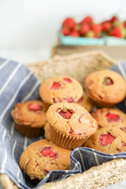 Strawberry Maple Muffins on a blue linen in a basket