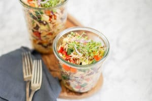 Orzo pasta salad in 2 lunch-size glass containers