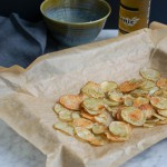 Homemade chips in a pan on parchment paper