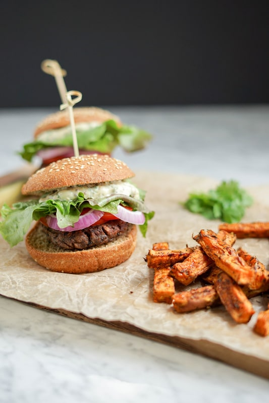 close-up of a Black Bean Burger with Sweet Potato Wedges