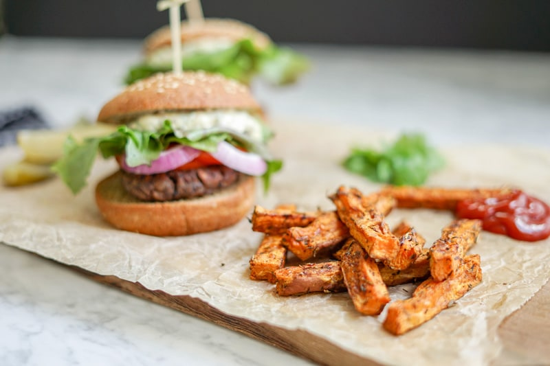 close-up front view of a Black Bean Burger with Sweet Potato Wedges