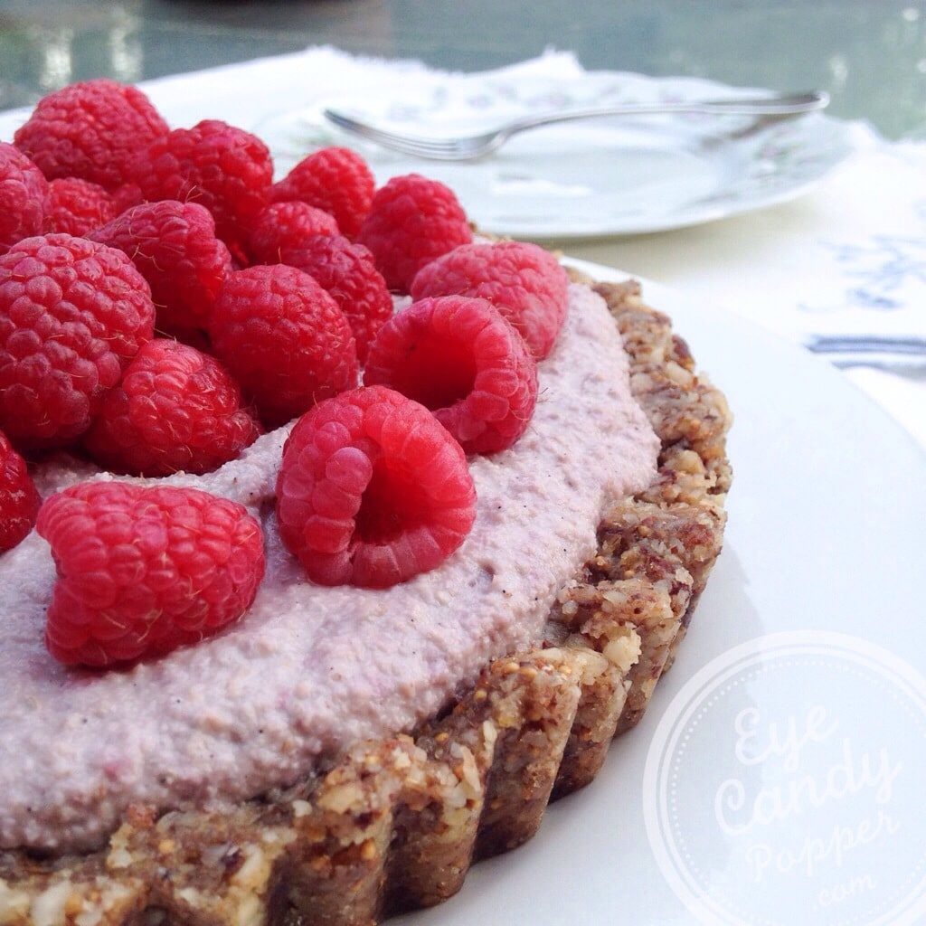 Delicious raw pie made with nuts, figs and fresh raspberries