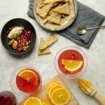 Amaretto cranberry shrub cocktail and herbs black pepper crackers